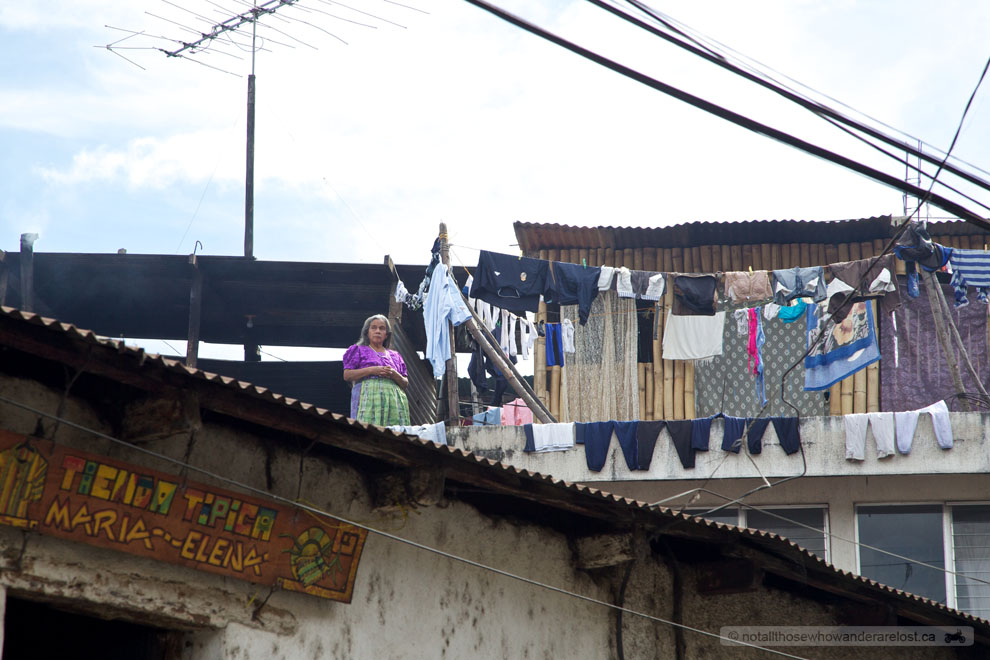 We spotted this elderly lady on the rooftop of her home hanging her laundry out to dry.