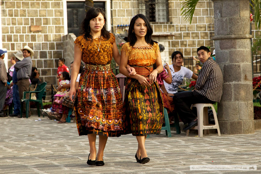 Two sisters walk through the town square and turn heads.